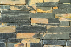 Pattern of granite stone wall surface. Pattern of black granite stone wall surface background Stock Image