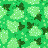 Pattern with grape. Seamless pattern with grape tassels on green background Stock Illustration