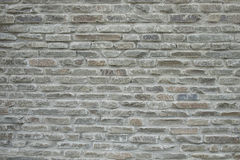 Pattern gray color of modern style design decorative cracked real stone wall surface with cement Stock Image