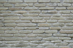 Pattern gray color of modern style design decorative cracked real stone wall surface with cement Royalty Free Stock Photography