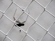 Grey square lattice and the keyhole. Pattern of gray square grid lattice with keyhole Stock Image