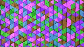 Pattern of green, brown, purple and blue triangle prisms. Wall of prisms. Abstract 3d background. 3D rendering illustration Stock Image