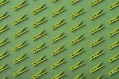 Pattern of green clothes pins stock images