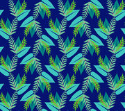 Pattern  with  green leaves on blue background Stock Photography