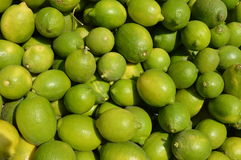 Pattern of green limes background. A pile of limes on the market, making lime pattern for background Stock Photos