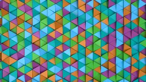 Pattern of green, orange, purple and blue triangle prisms. Wall of prisms. Abstract 3d background. 3D rendering illustration Royalty Free Stock Image