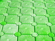 Pattern of green plastic buoy floating on sea surface Stock Images