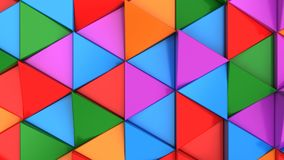 Pattern of green, red, purple and blue triangle prisms. Wall of prisms. Abstract 3d background. 3D rendering illustration Royalty Free Stock Image
