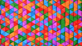 Pattern of green, red, purple and blue triangle prisms. Wall of prisms. Abstract 3d background. 3D rendering illustration Stock Images