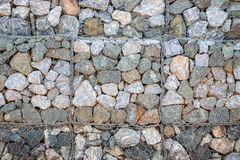 Pattern of grey stone wall with metal grid texture for backgroun Royalty Free Stock Photography
