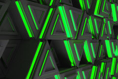 Pattern of grey triangle prisms with green glowing lines Stock Photography