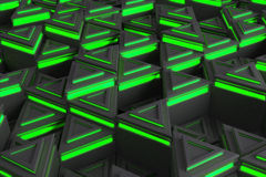 Pattern of grey triangle prisms with green glowing lines Stock Images