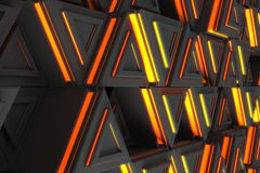 Pattern of grey triangle prisms with orange glowing lines Stock Images