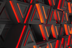 Pattern of grey triangle prisms with red glowing lines Stock Images