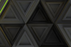 Pattern of grey triangle prisms with yellow glowing lines Royalty Free Stock Photography