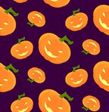 Pattern for Halloween with a laughing pumpkin. A seamless pattern for celebratory Halloween festivities with laughing pumpkins Stock Images