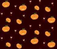 Pattern for Halloween with pumpkins and lanterns. A seamless pattern for the holiday celebration of Halloween with smiling pumpkins and small magical Royalty Free Stock Image