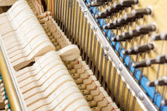 Pattern of hammers and strings inside piano Stock Image