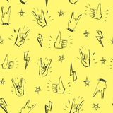 Pattern with hands showing rock and roll signs. Seamless pattern with hands showing cool rock and roll signs. Hand drawn background for your design Royalty Free Stock Images