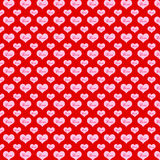Pattern hearts on a red background Stock Images