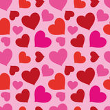 Pattern Of Hearts Seamless Texture. Smart festive pattern of red and pink hearts on a pink background. Seamless texture. Fabrics, textile, tablecloth Royalty Free Stock Image