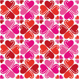 Pattern Of Hearts Seamless Texture. Smart festive pattern of red and pink hearts on a white background. Seamless texture. Fabrics, textile, tablecloth Stock Photography