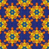 Pattern of hexagonal elements. In ethnic style, painted figures of curls, yellow with orange on a blue background Royalty Free Stock Photography