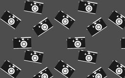 Pattern of hipster, black and white, beautiful, vintage retro cameras. Seamless texture. Vector illustration Stock Photography