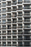 Pattern of hotel balconies. Apartments or hotel rooms from outside Stock Images