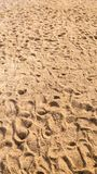 The pattern of the human footsteps on the sand at the beach. royalty free stock photos
