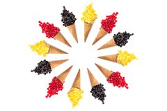 Pattern ice cream with cones and various  frozen berries. Mango, pineapple,  red and black currant on white background. Summer and Sweet menu concept flat lay Royalty Free Stock Images