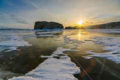 Pattern on ice of lake Baikal during sunset. Siberia Russia royalty free stock photo