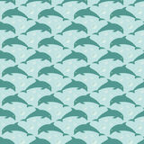 Pattern with jumping dolphins Stock Images