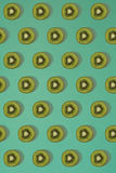 Pattern of kiwi. Top view of the sliced kiwi on blue background. Minimal flat lay concept. Stock Photography