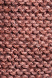 Pattern knitted. From wool brown orange Royalty Free Stock Photo