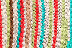 Pattern of knitted rug, background photo texture. Colorful striped abstract pattern of knitted rug, background photo texture Royalty Free Stock Image