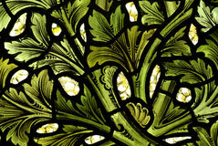 Pattern of leafs in stained glass. Stained glass window with leafs Stock Images
