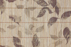 Pattern leaves on bamboo wood of background. Stock Photo