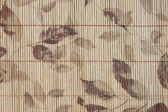 Pattern leaves on bamboo wood of background. Royalty Free Stock Photos