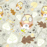 Pattern of leaves and owls. Seamless graphic pattern of leaves and owls on a light background Stock Photo