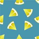 The pattern of lemons on a blue background. Stock Photos