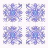 Pattern of lilac snowflakeson a white background stock photo