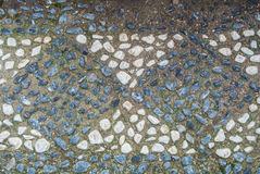 A pattern of little stones at a footpath in the park Royalty Free Stock Photos
