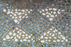 A pattern of little stones at a footpath in the park Royalty Free Stock Images