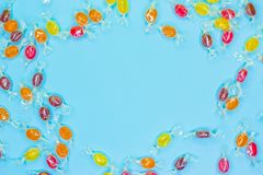 Pattern lollipops, candy on colorful white frame background, top view flat lay. stock image