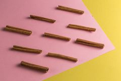 Pattern is made of cinnamons. flat lay royalty free stock photo