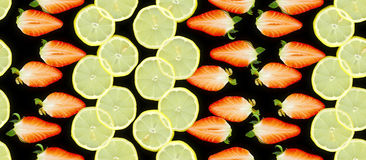 Pattern made by halved strawberries and lemon slices Royalty Free Stock Photography