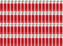 Pattern made from small, manual fire extinguisher, isolated on a white background with a clipping path. stock images