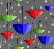 Pattern made of umbrellas and rain drops Royalty Free Stock Photos