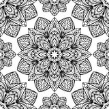 The pattern of mandalas. Seamless oriental pattern of round black elements on a white background. Vector pattern of intricate mandalas symmetrically located Royalty Free Stock Images